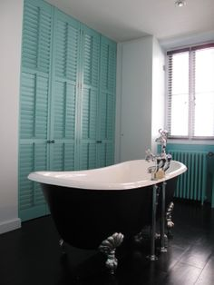 desire to inspire - clawfoot tub and cleverly hidden storage.... love