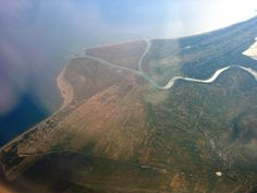 Mouth of the river Bojana/Buna in Northern Albania/Montenegro. The Albanian beach resort Velipoja to the left, Montenegro on the top of the picture.