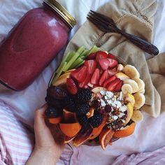 vegantality:  albeeats:  Banana strawberry cherry smoothie and the biggest fruit salad.  woow!