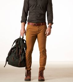 color palette, grey mustard and brown. Tucked in shirt and man bag.