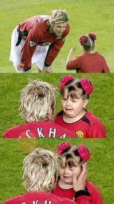 David Beckham comforting a crying child