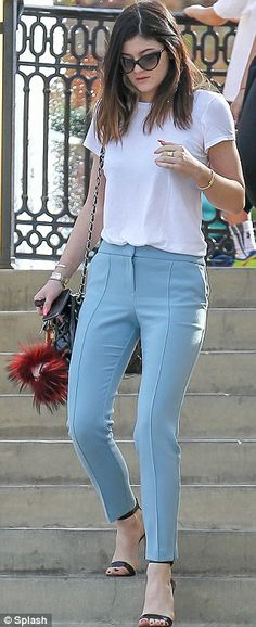 Kylie Jenner Retro chic: The 16-year-old went for a modern take on a  Fifties look by wearing a white top, pastel blue trousers, black leather heels