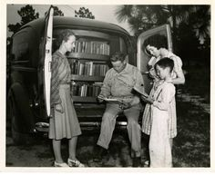 Cumberland County bookmobile. North Carolina Work Projects Administration Library Project showing rear of bookmobile with group of people reading, July 2, 1941 ^cs
