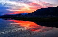 """""""Fire in the Sky at Flat Creek"""" by Jeff Clow, via 500px."""