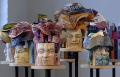 Book carvings from the culture warrior series. Long-Bin Chen (Taiwanese, b.1964) Halsey Institute of Contemporary Art.