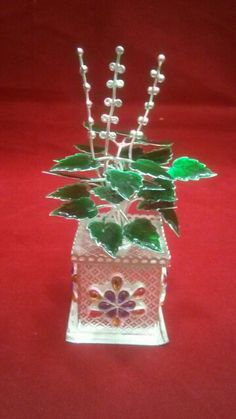 Silver Tulsi plant Silver Jewellery Indian, Gold Jewellery Design, Silver Jewelry, Naming Ceremony Decoration, Ceremony Decorations, Tulsi Plant, Silver Pooja Items, Pooja Room Door Design, Silver Ornaments