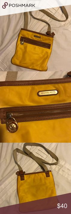 Michael Kors Cross Body Michael Kors cross body bag- yellow with brown leather. Perfect for spring/ summer. It has some light staining- more so on the back from jeans but it's not too bad as you can see in the photos. Measurements are about 9.5H x 10W no lowball offers please. Firm price Michael Kors Bags Crossbody Bags