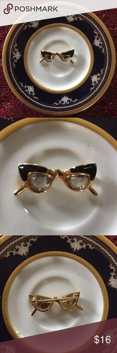 """Vintage Cat Eye Glasses Brooch Pin What a fun pair of retro Cat-Eye Glasses! This gold-tone Brooch Pin is accented in black enamel with white rhinestones as the eyeglasses. Measures 1-1/4"""".  In excellent preowned vintage condition. Vintage Jewelry Brooches"""