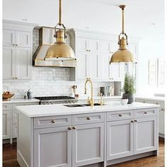 Grey Kitchen Cabinets and Brass Light Fixtures
