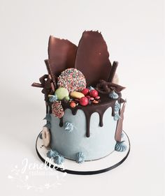 Chocolate overload drip cake. By Jenelle's Custom Cakes.