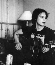 I love that he is wearing a Siouxsie and the Banshees shirt!
