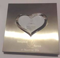 "silver-eunhae:  [INFO] USA-ELF plans to send a wedding gift to Sungmin and SaEun: this silver album with their names  engraved. cr: choding(?) "" Be happy SungMin, we love you ♥ """