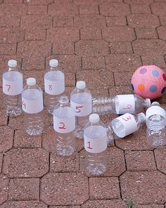 Activities: Bowling for Addition 1.Cut wide bands out of paper for each bottle and number them with different point values 1-10.  2.Tape to bottles  3.Arrange the bottles in a triangular shape.  4.Divide a paper into columns for each player. Take turns rolling the ball to knock down pins. Count up the numbers on each pin that gets knocked over. Whoever gets the most points wins!   6.If you want to make the game a little more challenging, try filling the bottles with a small amount of sand.