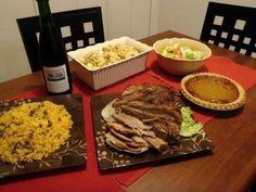 Pernil, arroz con gandules, ensalada, pasta rusa de pollo y postre de calabaza (Latin food)