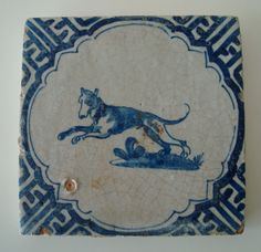 Delft tile with 'wanli' fretwork border and central decoration of a hound- Dutch, 17th century