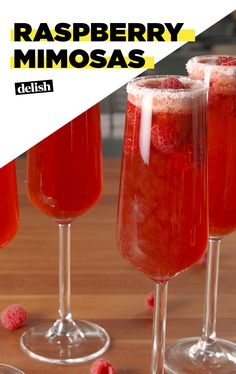 If you're not drinking Raspberry Mimosas all spring, you're doing it wrong. Get the recipe at Delish.com. #recipe #easyrecipe #easy #cocktail #brunch #mimosa #raspberry #berries #fruit #drinking #wine #champagne