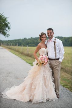 What a perfect modern country chic wedding! The bride's light pink dress is a romantic alternative to a traditional white dress.