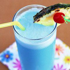 Mad Men Week: Joan's Blue Hawaiian:      1 ounce blue Curaçao      1 ounce light rum      1 ounce cream of coconut      2 ounces pineapple juice      1 cup ice      Garnish: cherry, pineapple slice        Blend blue curaçao, rum, cream of coconut, pineapple juice and ice.      Pour into a tall glass.      Garnish with a cherry and a slice of pineapple. Aloha!
