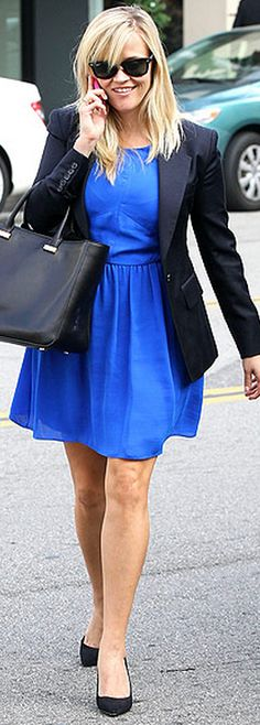 Who made Reese Witherspoon's black sunglasses, black tote handbag, and black sunglasses?