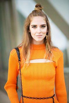 Chiara Ferragni wears a ribbed cutout Louis Vuitton top, chain belt, shoulder bag, and a single Louis Vuitton earring