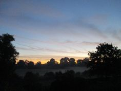 Dawn photographed by Anthony Sargeant from the bedroom window of his Shropshire home at 7 am on 3rd October 2016. The mist still cloaks the water meadows of the River Corve below the house. Shropshire is a wonderful quiet corner of England.