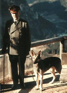 A very rare photo of Adolf Hitler and his German shepherd, Blondie, at his private residence in the foothills of Bavaria, the Berghof.