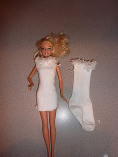 Dress Barbie - use old socks * Just cut the toe off at the length you want , cut slits on top sides for arms *Pull on , make long gowns or short dresses *No Sew *