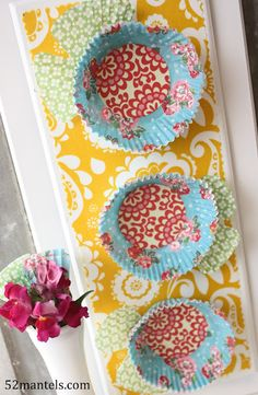 Love the cupcake papers. Makes me want to try Modge Podge....