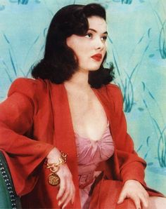 Gene Tierney 40s vintage fashion icon movie star color photo print ad red coat pink dress gold bracelet hair style