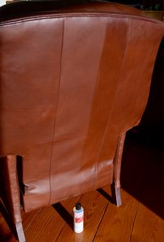 Leather recliner half treated with Leather Polish by Preservation Solutions.