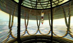 Songvår Lighthouse, October splendor | Lighthouses of Norway- This is the view from inside the light of the old lighthouse. The lens renders everything upside down —a really strange effect.