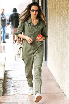 18cd3c0c71d Alessandra Ambrosio slips into Top Gun-style jumpsuit on rainy day