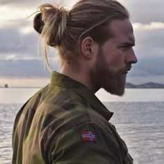 """A hunky Norwegian naval lieutenant has been dubbed a """"modern-day Viking"""" for conquering Instagram with his muscles, well-groomed beard, and tousled mane."""
