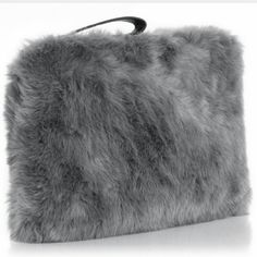 """Faux Fur Clutch Fabulous fluffy gray clutch has zip top and black wrist strap. Height 9.5"""" Width 13""""  88% Acrylic 12% Polyester Boutique Bags Clutches & Wristlets"""