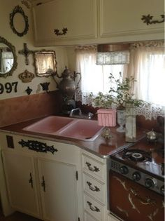 Vintage trailer renovated kitchen. Love the shabby chic look. #camper
