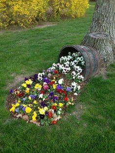 Wine barrel spilling flowers