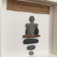 Gorgeous Fathers Day gift handmade with Co.Down beach pebbles. Frame is 23x23 cm Can be made to suit own specifications ie.more/less children