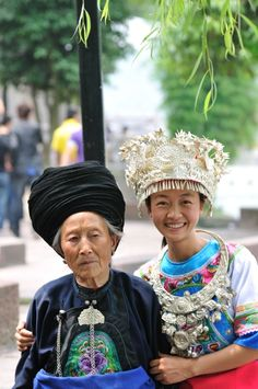 Most likely Miao minority judging by the silver headress the young woman is wearing. Taken in the town of Feng Huang (Phoenix Town) Hunan Province, China. I'd like to go there one day.