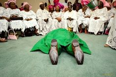 Yoruba Groom lies flat down to ask Bride's family permission to wed her as is customary in the culture. It's a sign of humility and respect.