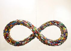 Mobius Beltway (alternate view), 2013. Matchbox cars mounted on aluminum, plywood frame, 70 x 30 in.