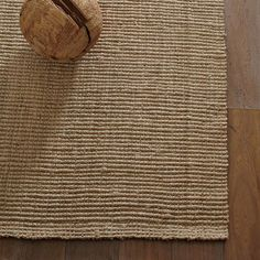 This rug supposedly traps dirt and such but shakes out easily. Sounds low maintenance to me!                Jute Boucle Rug - Flax | west elm
