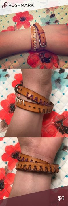 Leather wrap bracelet 🌸 Leather wrap bracelet with white and purple detailing. Is adjustable in size. Has a spot that looks as if it had glue on it but could be cleaned off. Other than that it's in great shape! 🌼 Jewelry Bracelets