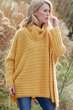 Knitted ladies' poncho with slouchy rolled neck. Shop the women's pattern now at The Knitting Network
