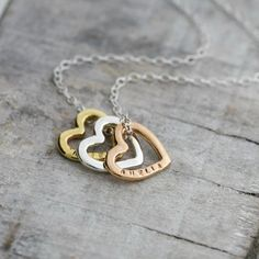 Personalised Tricolore Love Necklace  A simply lovely tricolore hearts necklace in sterling silver, rose gold and yellow gold plate. We hear cupid calling! This is one of our favourite new designs of 2015 and is a variation on the ever popular 'Family Names Heart Necklace'. On trend mixed metals combined with the always-sentimental love hearts. Perfect for personalising up to eight characters with a couple's name, special date or meaningful word such as 'Hope', 'Love', or 'Forever'. Each…