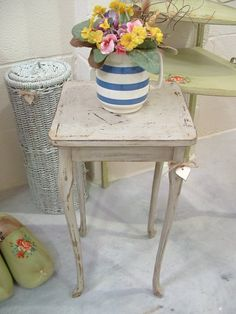 Lovely small side table with long elegant legs.  Vintage item.     Solid Wood with 'Herring Bone' veneered table top.     Painted a lovely distressed look vintage cream/grey.   Waxed finish.   Beautiful shabby chic.