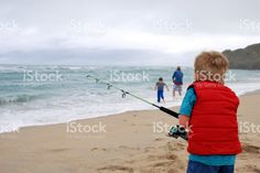 Child Surf Fishing in Summer with his Family royalty-free stock photo Family Stock Photo, Family Photos, Kiwiana, Surf Fishing, Image Now, Beach Mat, Surfing, Royalty Free Stock Photos, Outdoor Blanket