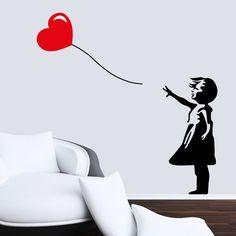 Menina com balão em forma de coração Banksy