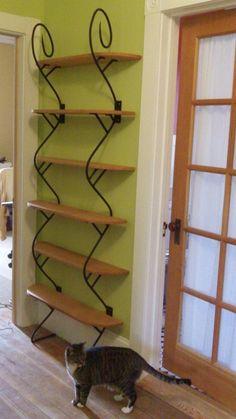 Wrought-iron bookshelf. $350.00, via Etsy.