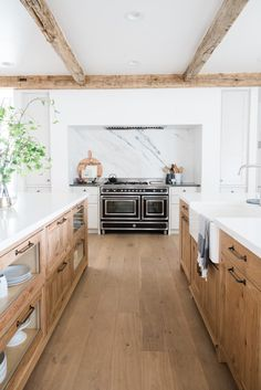 Morgan Farmhouse – Kitchen – Deco Design Furniture – Utah's Finest Custom Built Cabinetry Rustic wood beams, hardwood floors and cabinets beautifully contrast the sophisticated marble slab backsplash in this farmhouse kitchen Home Decor Kitchen, Kitchen Remodel, Kitchen Decor, Home Remodeling, Interior Design Kitchen, Sweet Home, Home Kitchens, Modern Farmhouse Kitchens, Kitchen Design