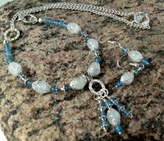 Gorgeous hand made beaded blue agate and white Ice Flake quartz crystal gemstone necklace and earring set.